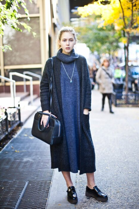 Girl wearing a long knitted dress in blue color