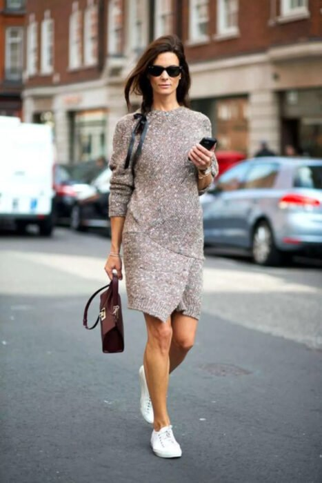 Girl wearing a long knitted dress in light brown color