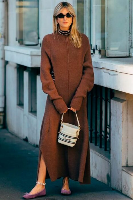 Girl wearing a long knitted dress in brown color