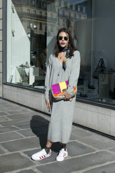 Girl wearing a long knitted dress in gray color