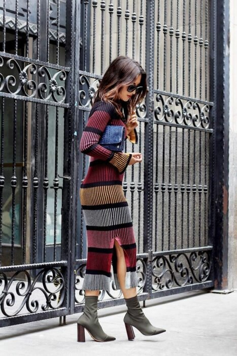 Girl wearing a long knitted dress in different colors