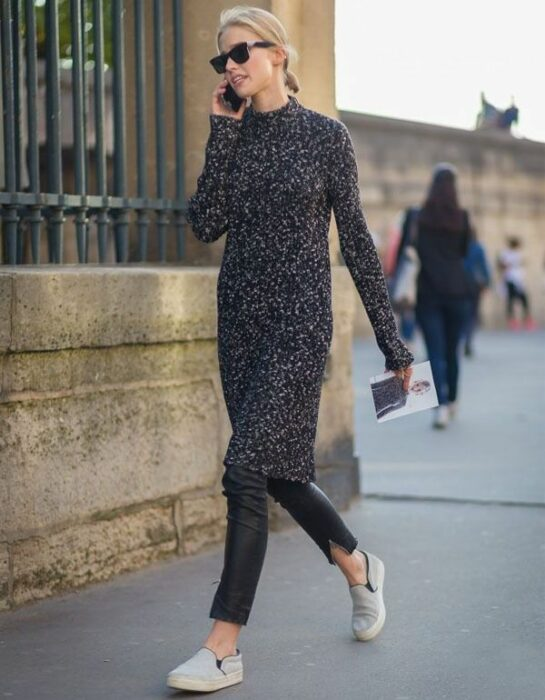 Girl wearing a long gray knitted dress with black leggings