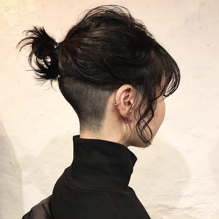 girl with short black hair, shaved at the nape with black high neck top