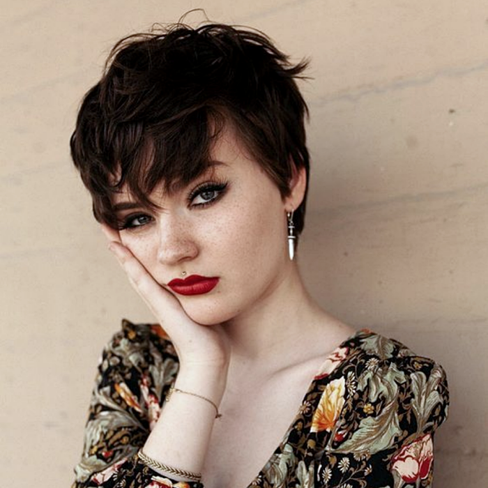 short brown hair girl with pixie cut, front volume and v-neck floral top
