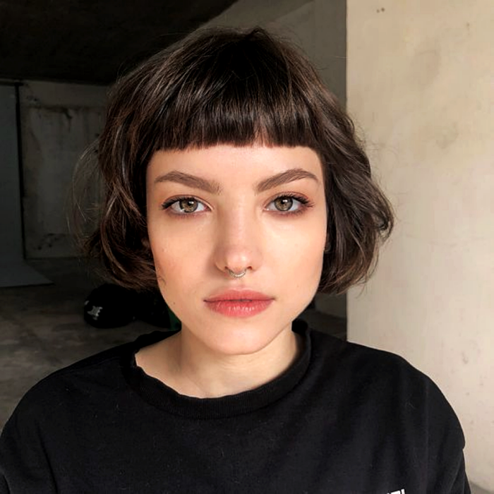 brown haired girl wearing french bob haircut, french bob, with black t-shirt