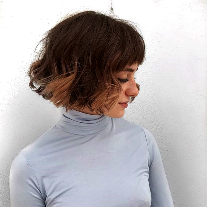 light brown haired girl with french bob haircut, french bob, and gray long sleeve high neck top