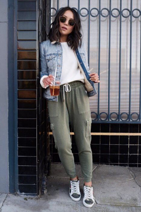 Girl wearing green pants with a white shirt and jean jacket