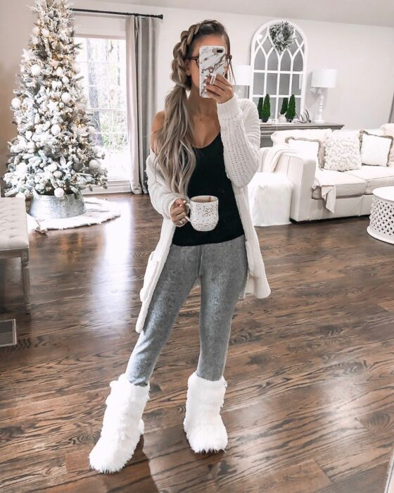 Girl wearing jeans pants, plush boots and big sweater