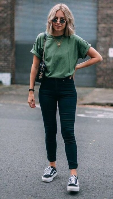 Girl wearing black jeans with a green t-shirt