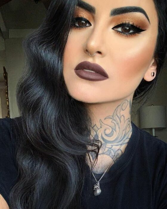 Long black hair brunette girl with water waves with brown lipstick and brown shadows with long black outlines