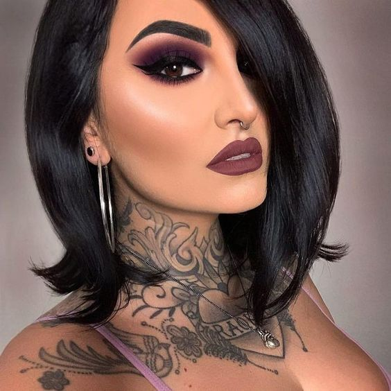 Brunette girl with short hair with purple lipstick with purple smokey eye