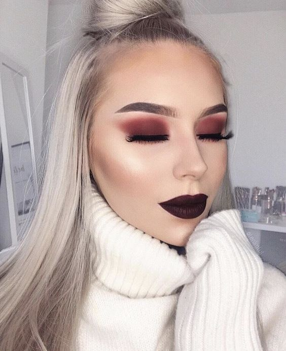 Long blonde hair blonde girl with dark red lipstick and smoky shadows in red color