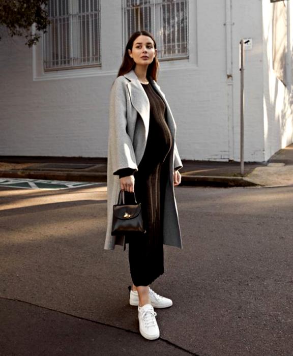 brown haired girl wearing black maxi dress, gray long coat, black leather handbag