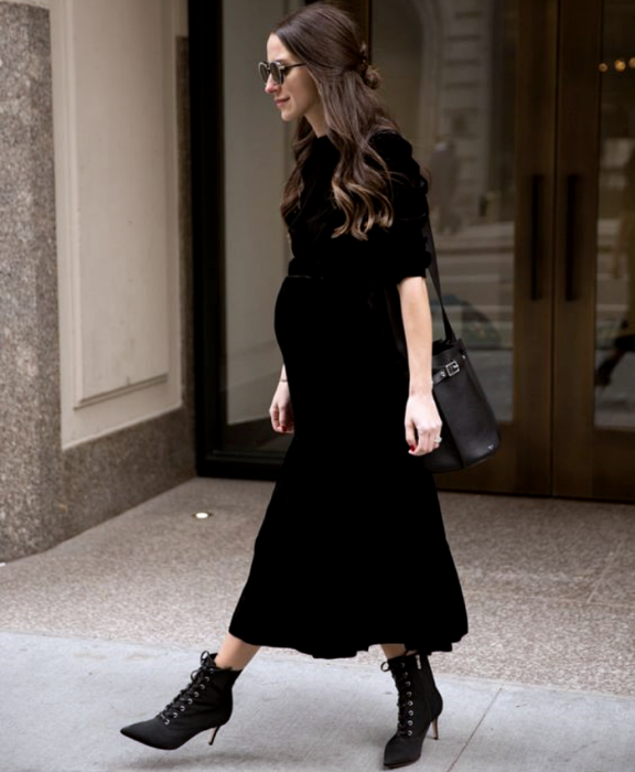long brown hair pregnant girl wearing sunglasses, a 3/4 sleeve black maxi dress and high heel ankle boots