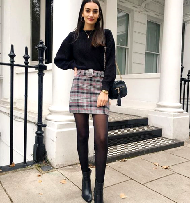 long brown hair girl wearing black long sleeve sweater, gray plaid mini skirt, semitransparent black tights, heeled leather ankle boots and black leather handbag