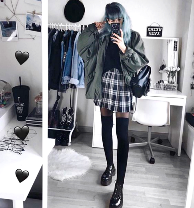 long blue haired girl wearing black top, dark green oversized jacket, plaid plaid mini skirt, long black tights, black leather backpack and black platform loafers