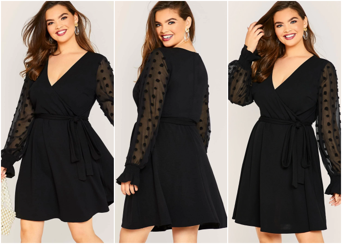 curvy brown hair girl wearing black dress with semitransparent long sleeves, fitted at the waist with V-neckline