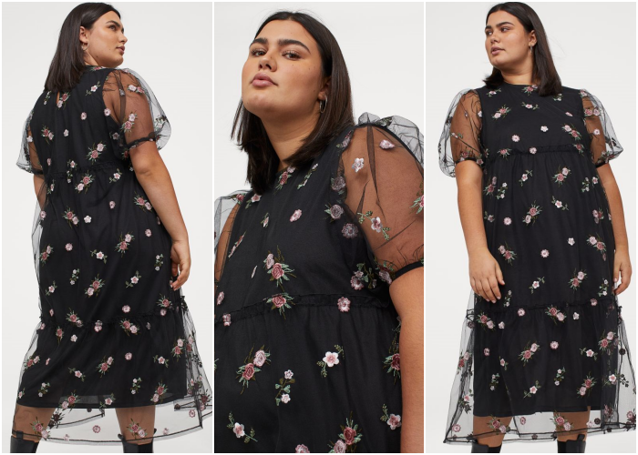curvy brunette girl wearing black dress with semitransparent fabric and flower embroidery, black leather ankle boots with heel