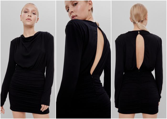 blonde girl wearing a long sleeve velvet black dress with neckline at the back