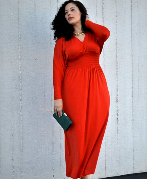 Chinese haired curvy girl wearing long red V neck long sleeve dress and black handbag