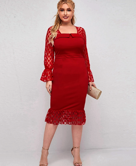 Curvy blonde girl wearing a red dress with a square neckline, long sleeves with red polka dots, waist trim, and beige glitter clutch bag