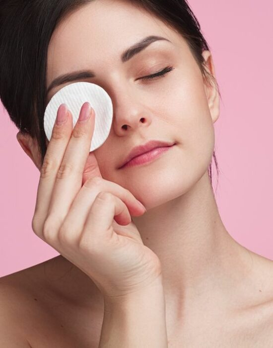 Girl with eyes closed with a cotton pad over her eye