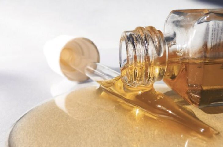 Rosehip oil dropper on a glass way table