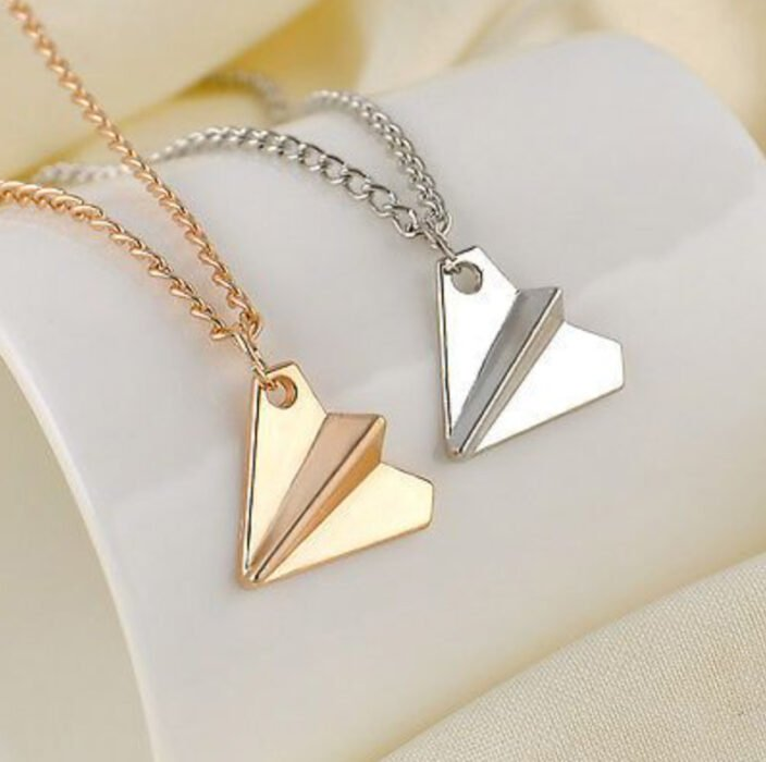 Friendship necklaces in rose gold and silver of paper airplanes
