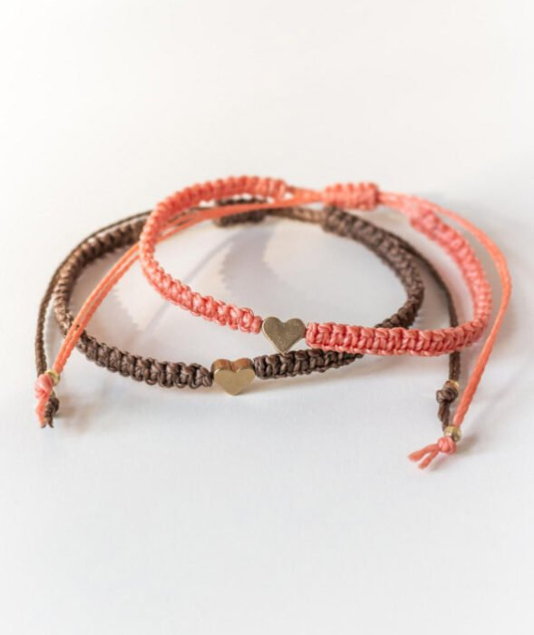 Brown and coral friendship bracelets with a gold heart charm