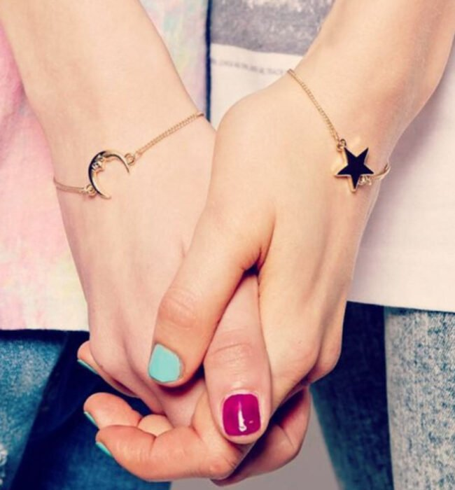 Friendship bracelets in gold color with charms of a sun and a moon