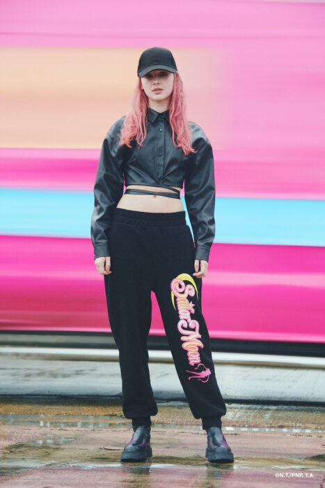 Girl wearing black sports pants printed with sailor moon; Bershka collection inspired by Sailor Moon