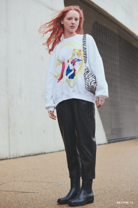 Girl wearing white sweatshirt printed with Sailor Moon; Bershka collection inspired by Sailor Moon