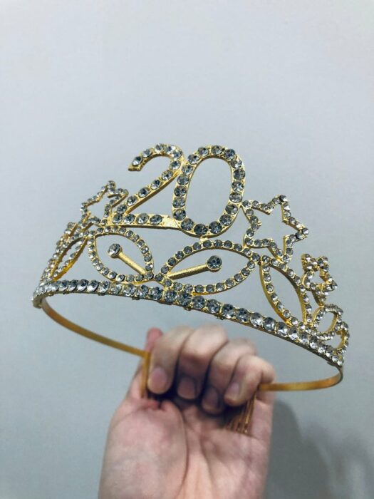 Gold number 20 crown with white crystal details