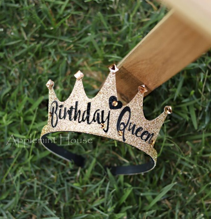 Gold birthday crown with sparkling stones on the tips with the message Birthday queen