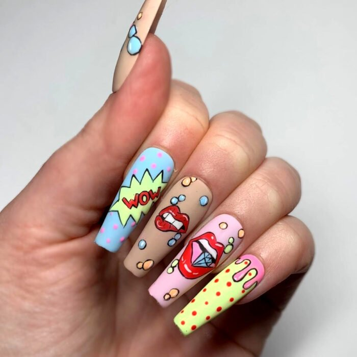 Hands with long square ballerina nails painted with colorful comic book nail polish, nude, sky blue, coffee, baby pink and yellow, with lips biting diamonds and onomatopoeias