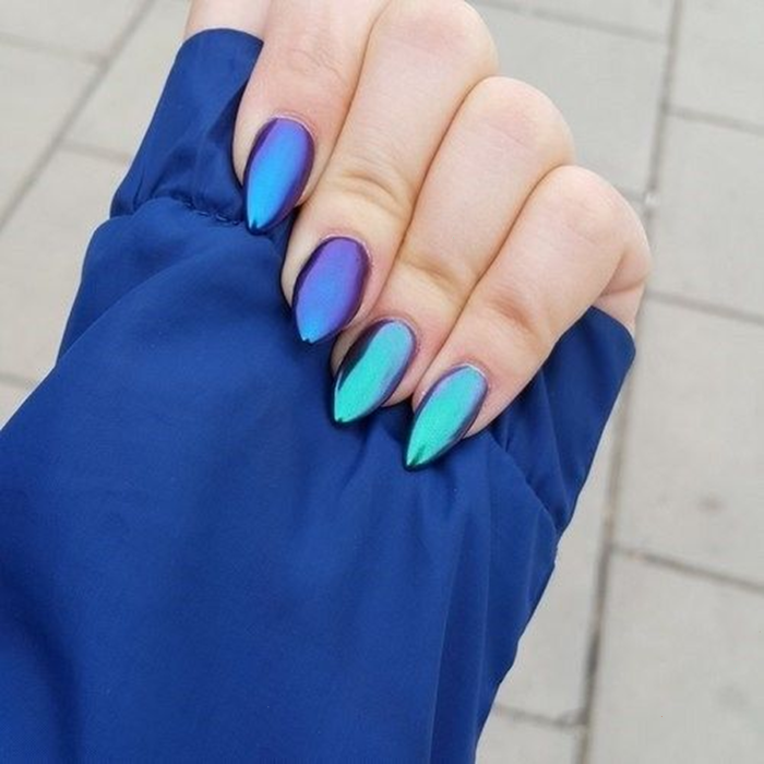 Girl with nails in an iridescent blue metallic design