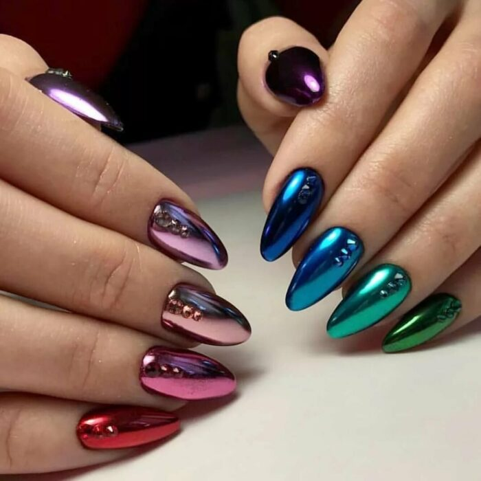 Girl with nails in a metallic design of different colors
