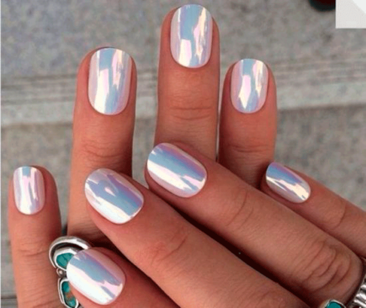 Girl with nails in a metallic pink design
