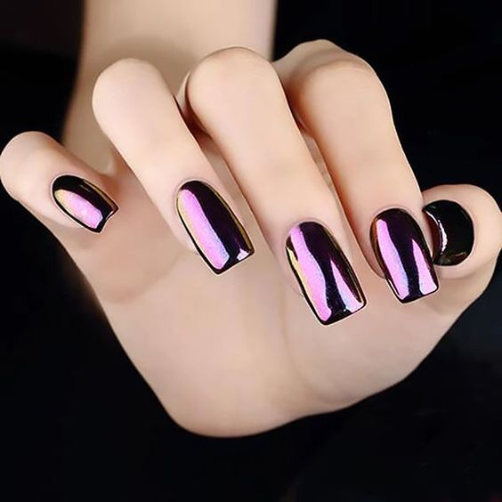 Girl with nails in a metallic design of grape color