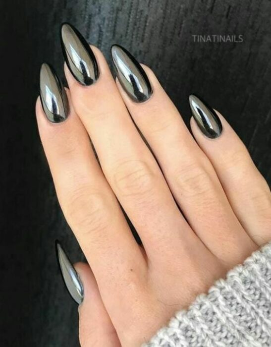 Girl with nails in a black metallic design