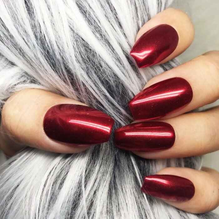 Girl with nails in a red metallic design