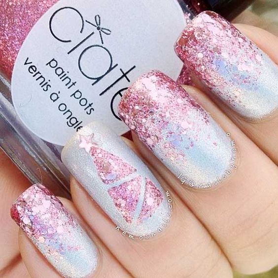 Silver base-tone nails with glitter pink decorations; Christmas manicure designs