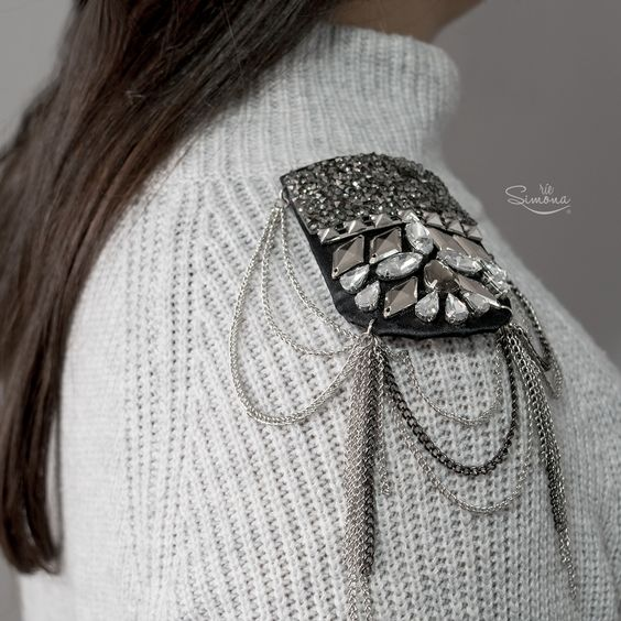 Girl wearing gray beaded shoulder pads over matching sweater; Shoulder pads to decorate your clothes