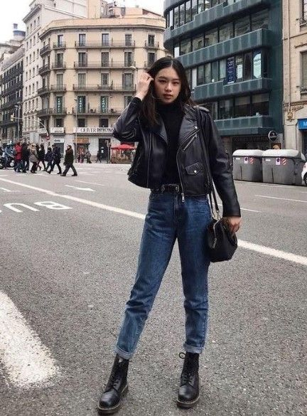 Girl in denim jeans, black turtleneck shirt, and leather jacket; Ideas for wearing a turtleneck shirt