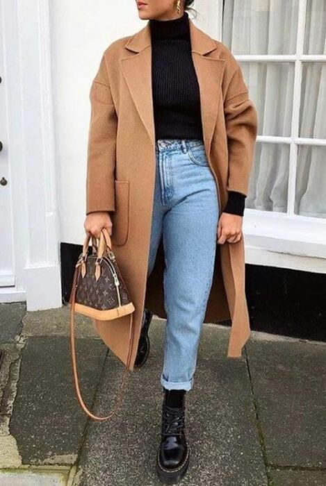 Girl in blue jeans, a black turtleneck and a khaki raincoat; Ideas for wearing a turtleneck shirt