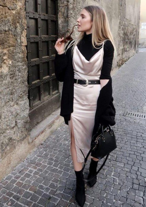 Girl in pink silk dress and black turtleneck shirt; Ideas for wearing a turtleneck shirt