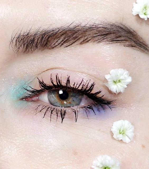 Simple eye makeup with blue eyeshadow on the tear and purple on the bottom