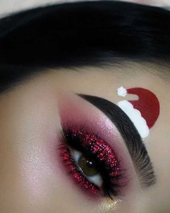 Girl with red eye makeup, with glitter; Cute makeup to celebrate Christmas