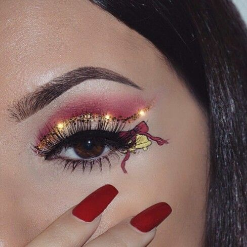 Girl with eye makeup in golden color with red; Cute makeup to celebrate Christmas