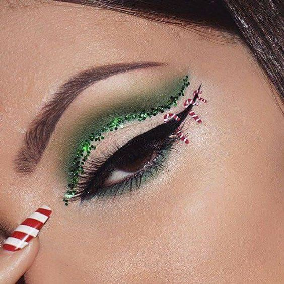 Girl with Christmas-inspired makeup outlined in green and black; Cute makeup to celebrate Christmas